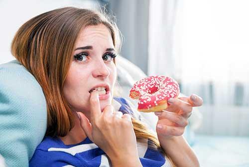 Appetite suppressant eating a dough nut